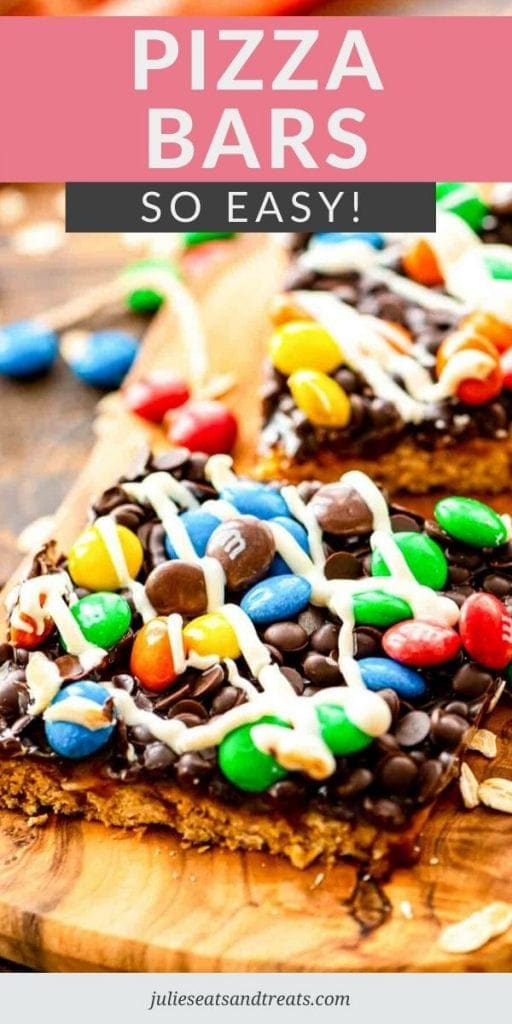 bars topped with m&m's and white chocolate on a cutting board with a pink and grey banner across the top reading pizza bars so easy