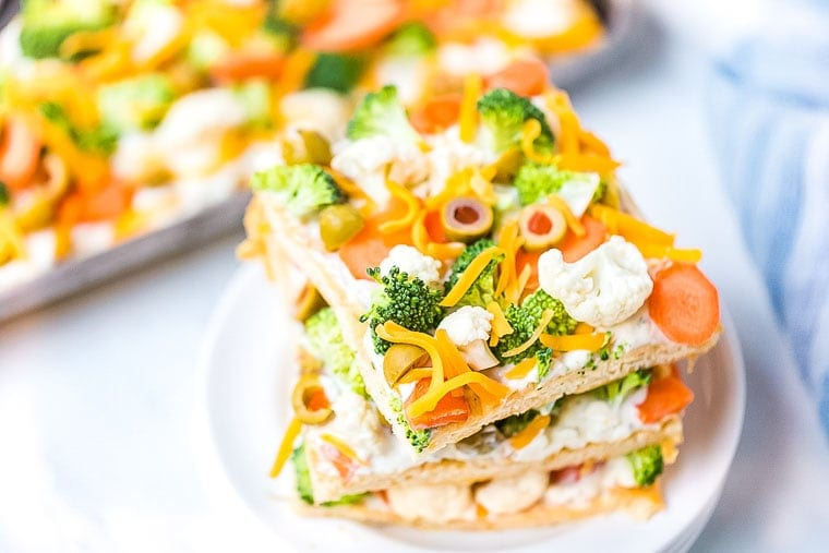 Veggie Pizza Recipe pieces stacked on plate