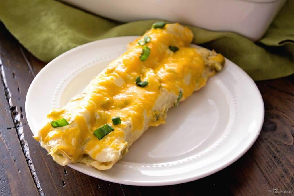 creamy chicken enchiladas on white plate