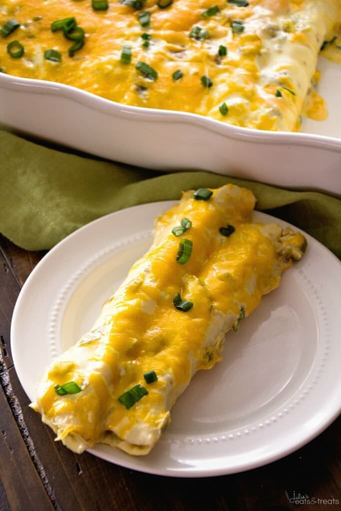Chicken enchilada recipe with two enchiladas on white plate