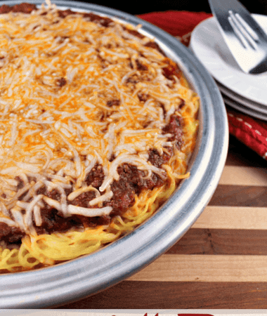 Spaghetti Pie ~ Hearty Meat Sauce Piled high on a bed of Spaghetti!