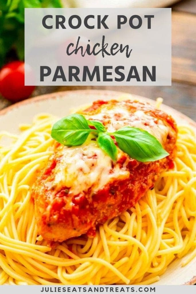 Prepared chicken parmesan on top of a plate of spaghetti noodles
