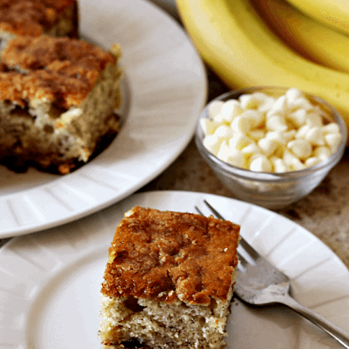 Banana Crumb Snack Cake Moist banana cake full of white chocolate chips and topped with brown sugar