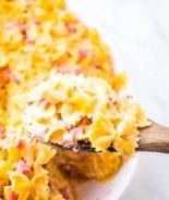 Cheesy Ham Bow Tie Pasta on wooden spoon