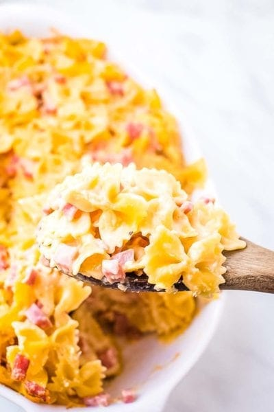 Cheesy Ham Bow Tie Pasta on wooden spoon