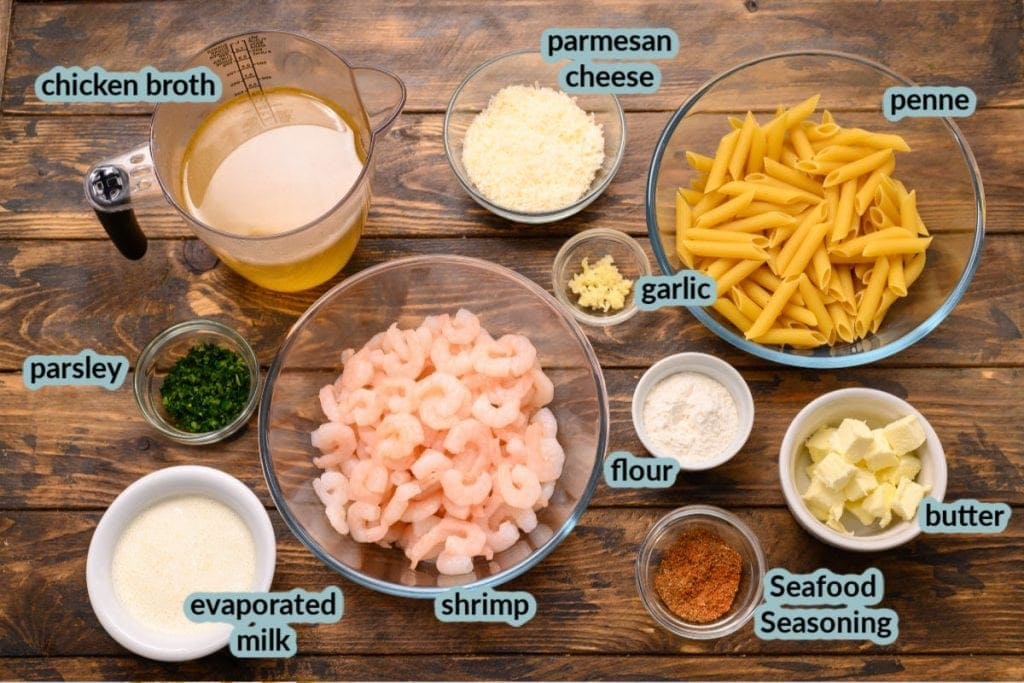 Overhead image showing ingredients needed for shrimp and penne pasta recipe