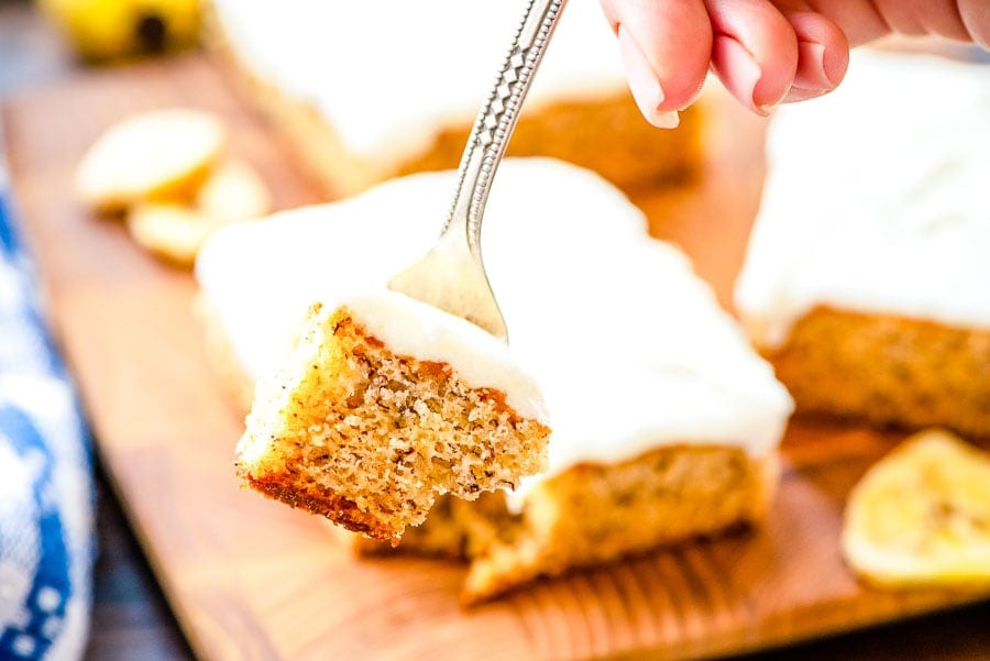 Banana Bars with cream cheese frosting on fork