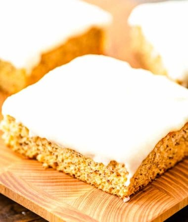Frosted Banana Bars on cutting board
