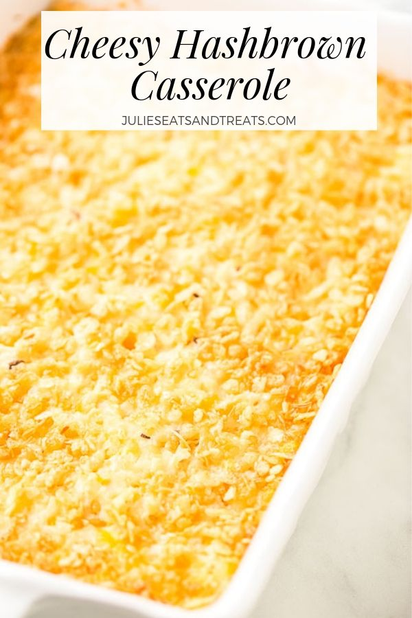 Cheesy hashbrown casserole in a white baking dish