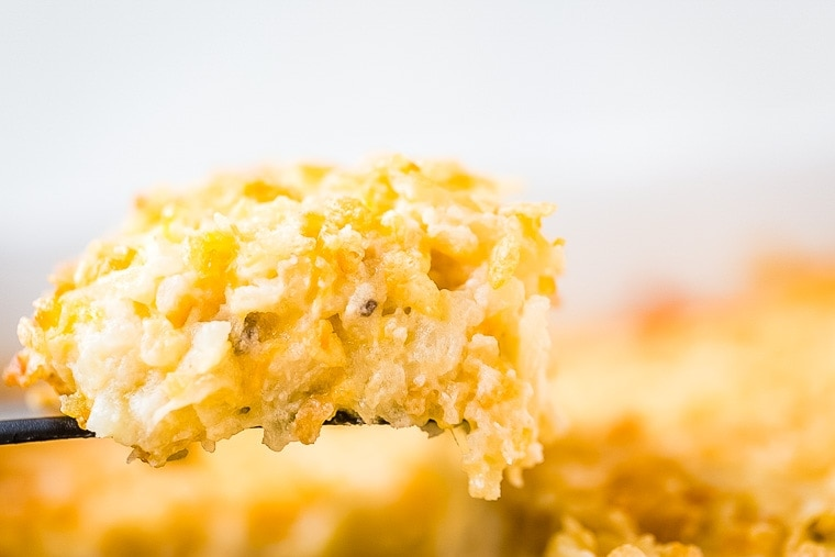 Cheesy Hash Brown Casserole on spoon.