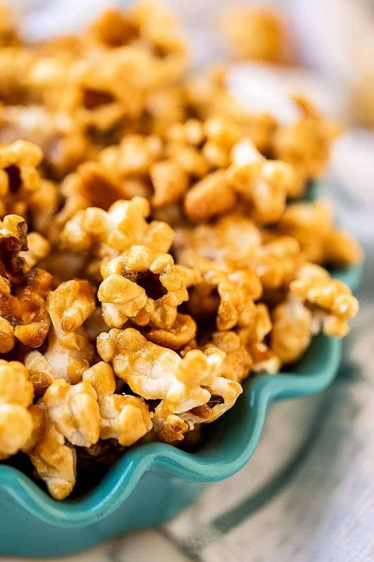 Teal Bowl with scalloped edge holding caramel corn.
