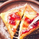 Monte Cristo sandwich Cut at a diagonal topped with jelly and powdered sugar
