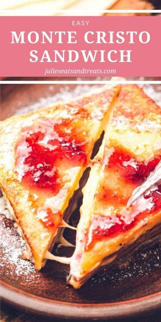 Monte cristo sandwich cut in half diagonally and dusted with powdered sugar