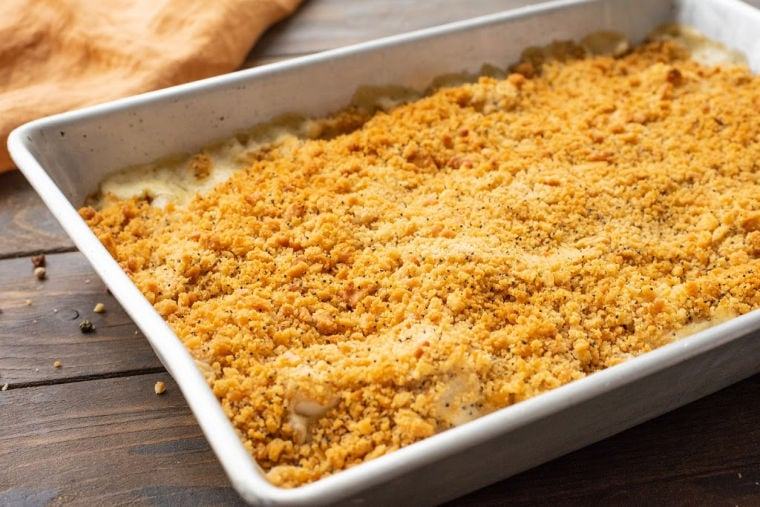 Baking dish with a chicken casserole topped with crackers