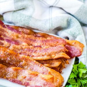 Oven baked bacon on a white plate