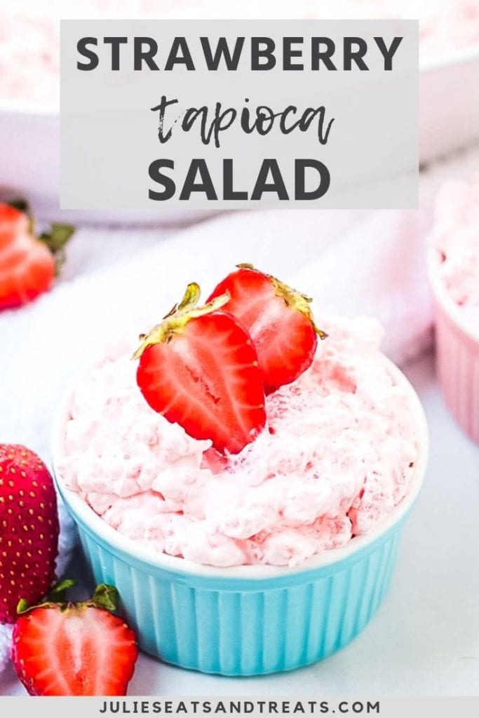 Strawberry tapioca salad topped with strawberries in a blue bowl