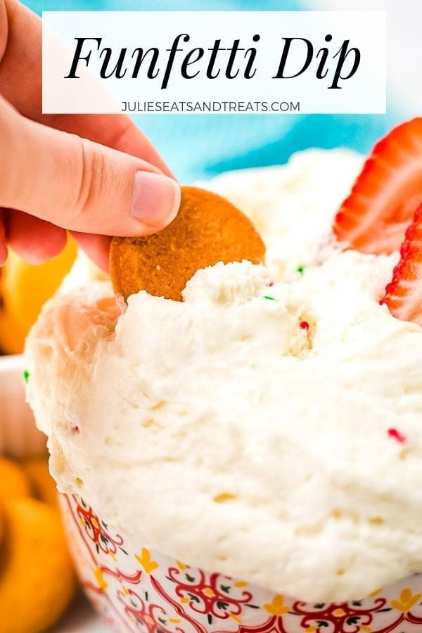 Hand dipping a cookie into a bowl of funfetti dip