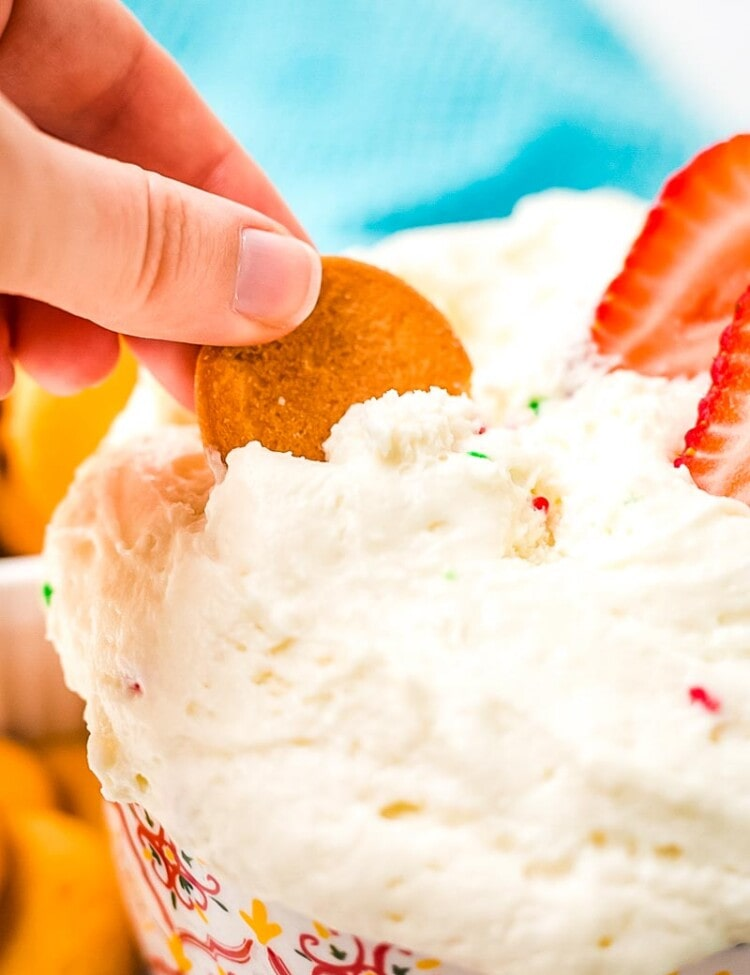 Cracker scooping Funfetti Dip from a bowl
