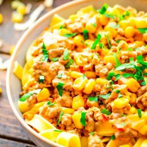 Easy Taco Stroganoff over pasta in a bowl