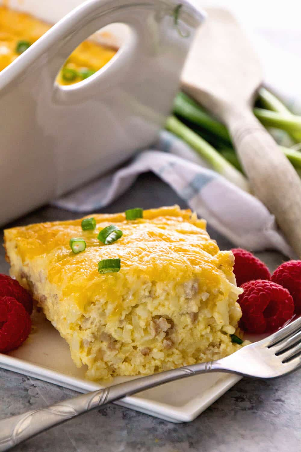 Sausage & Cheese Hash Brown Breakfast Casserole ~ Delicious Overnight Breakfast Casserole with Sausage, Hash Browns, Cheese and a Homemade Gravy! The BEST Breakfast Casserole Ever!