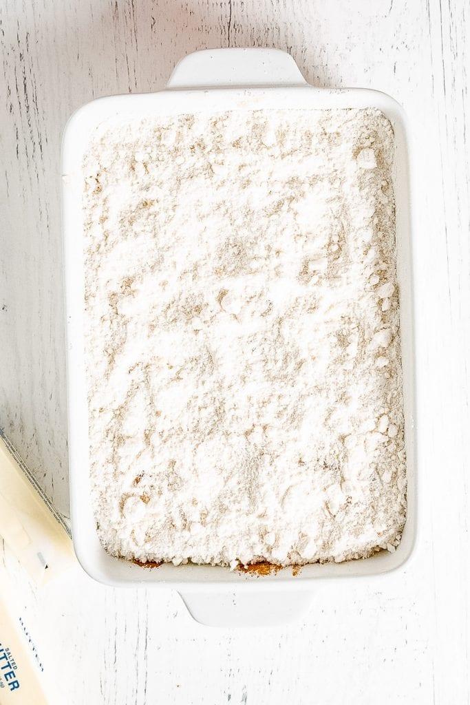 White Cake mix in white baking dish on white background