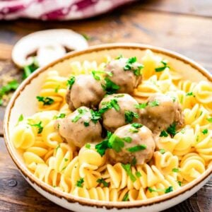 Bowl of Crockpot Swedish Meatballs and egg noodles