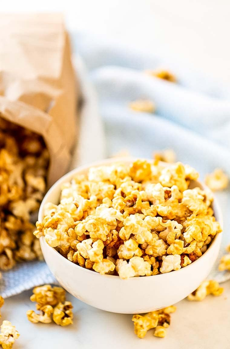 Caramel Corn in bowl with bag of it in background