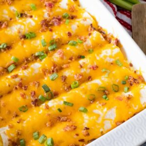 Overhead image of breakfast enchiladas in a white baking dish