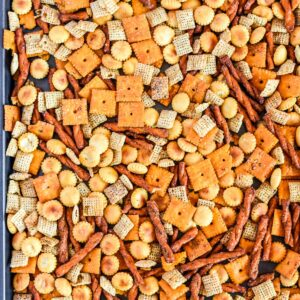 Sheet pan with chex mix on it