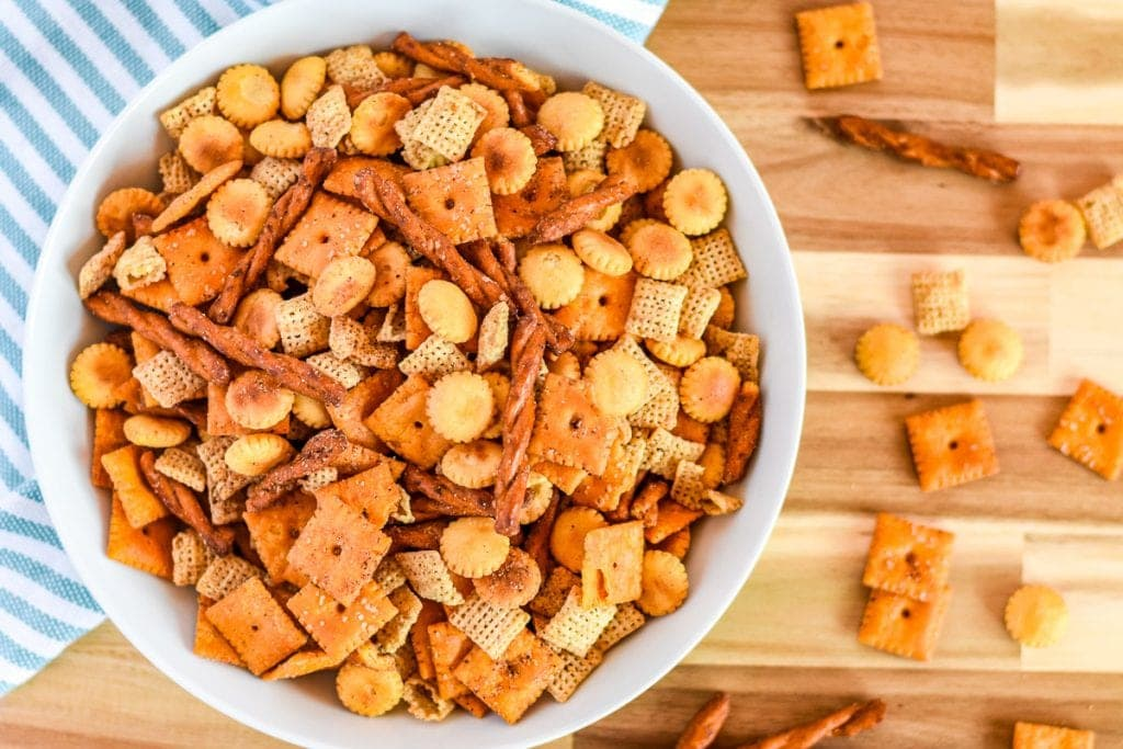 Wood cutting board with bowl of taco chex mix
