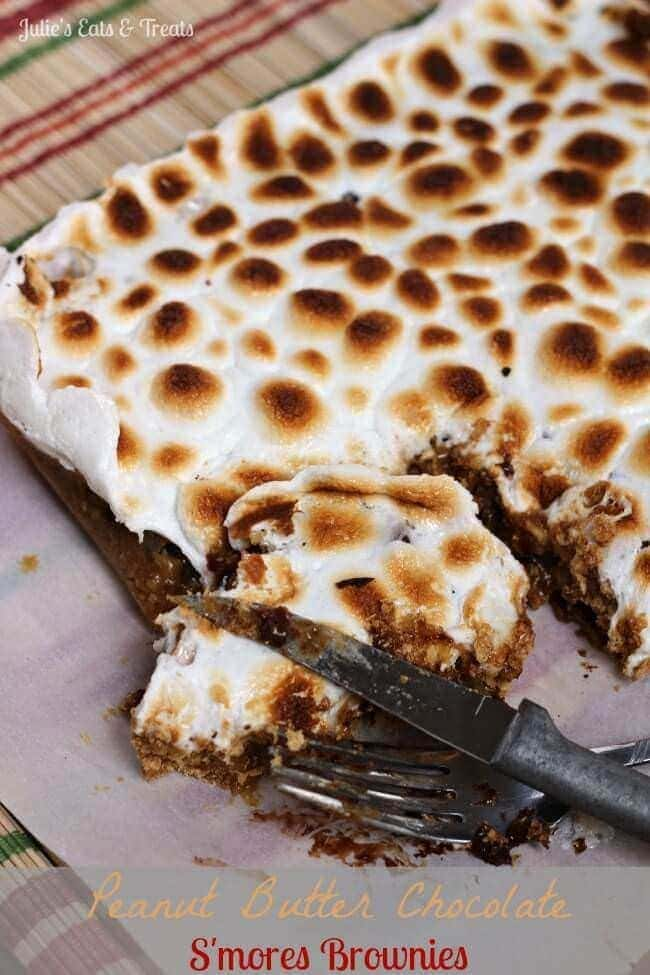 Peanut Butter Chocolate S'mores Brownies ~ Peanut Butter Blondies sandwiched between Graham Crackers and topped with Toasted Marshmallows and Chocolate Chips via www.julieseatsandtreats.com