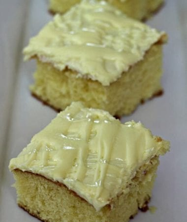 Lemon Glaze Swirl Cake ~ Lemon cake, topped with a lemon glaze and lemon frosting! via www.julieseatsandtreats.com