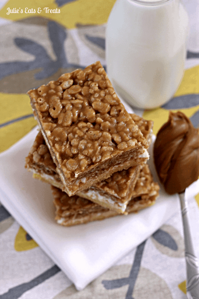 Biscoff Krispie Mallow Bars ~ A sinful buttery crust, topped with puffed marshmallows and then the final layer of Rice Kripies in a bath of Biscoff and White Chocolate Chips via www.julieseatsandtreats.com