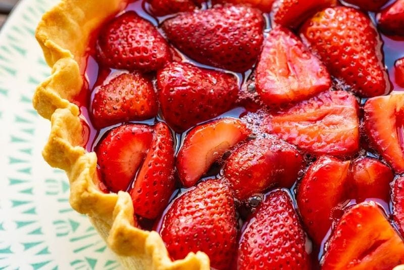 Closeup of Strawberry Pie on a plate showing strawberries in pie shell with jello filling