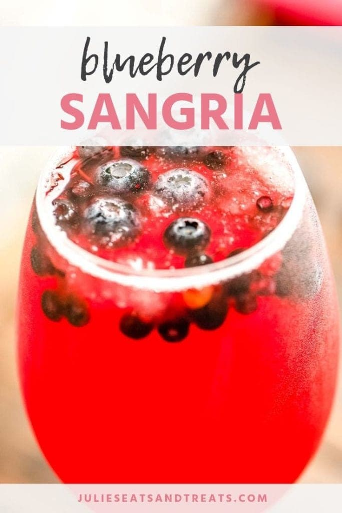 Blueberry sangria in a glass with blueberries