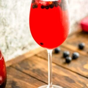 Wine Glass with blueberry sangria and blueberries