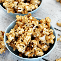 Peanut Butter Cashew Popcorn ~ Ooey, Gooey Peanut Butter Sauce smothering popcorn and cashews!