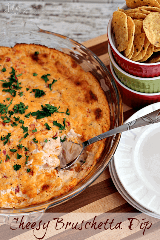 Cheesy Bruschetta Dip ~ Loaded with Cheese, Tomatoes and Garlic this dip is to die for and a must make!