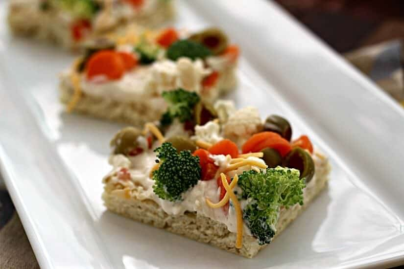 Vegetable Pizza ~ Soft, flaky crescent rolls loaded with broccoli, cauliflower, olives and carrots!