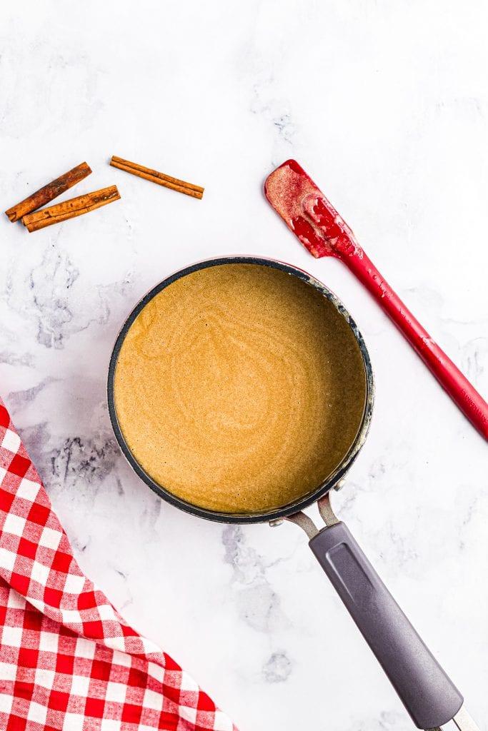 Saucepan with prepared caramel sauce