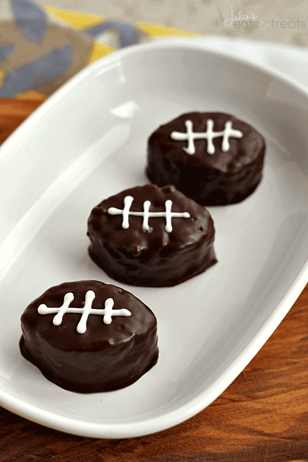 Football Scotcheroos ~ Festive treats for the big game! Ooey, Gooey Scotcheroos covered in chocolate!