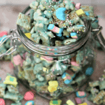 Open glass jar of lucky leprechaun munch snack mix
