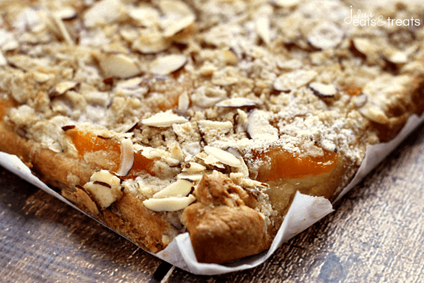 Peaches n Cream Bars ~ Flaky Crescent Rolls Layered with Cream Cheese, Peaches and a Crumb Topping!