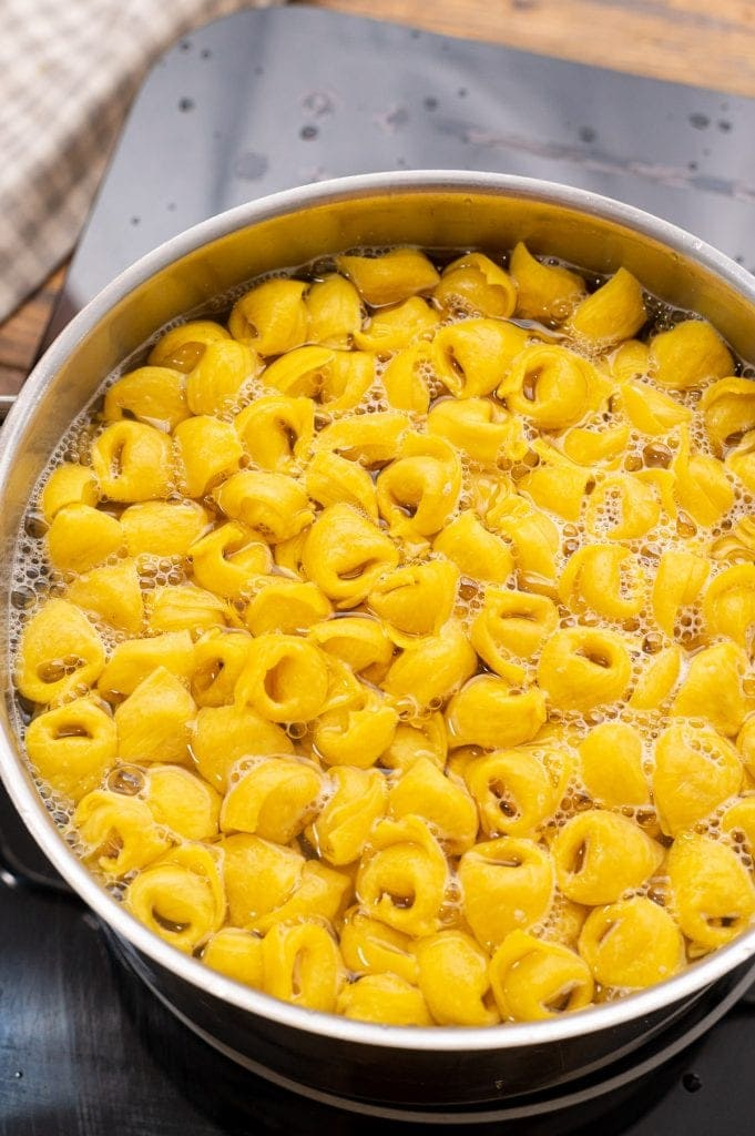 Cheese Tortellini cooking in water in a saucepan