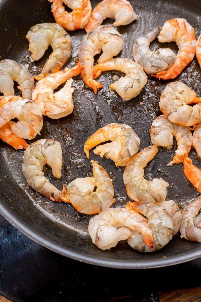 Skillet with shrimp cooking