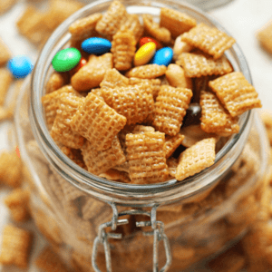 Glass jar of sweet and salty cashew snack mix