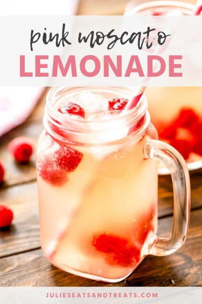 Glass mason jar mug of pink moscato lemonade with raspberries