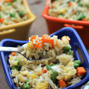 Three colorful bowls of easy chicken fried rice