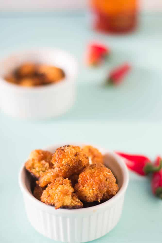 Cauliflower Bites in Honey Sriracha Sauce make a delicious and filling vegetarian meal that is a delicious balance of sweet and spicy! #vegetarian