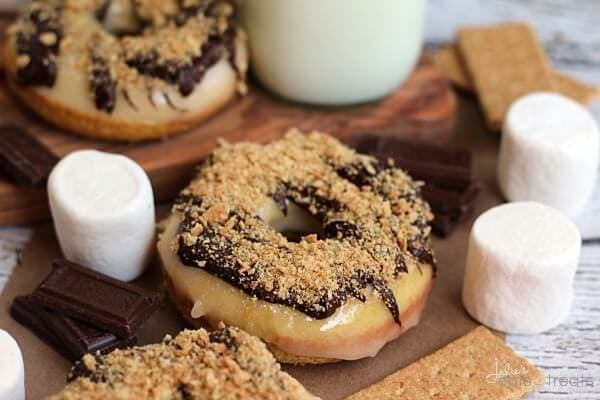 S'mores Donuts ~ Homemade Donuts Loaded with Marshmallow Frosting then Drizzled with Chocolate and Topped with Crushed Graham Crackers!